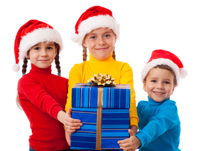 Three smiling kids with Christmas gift